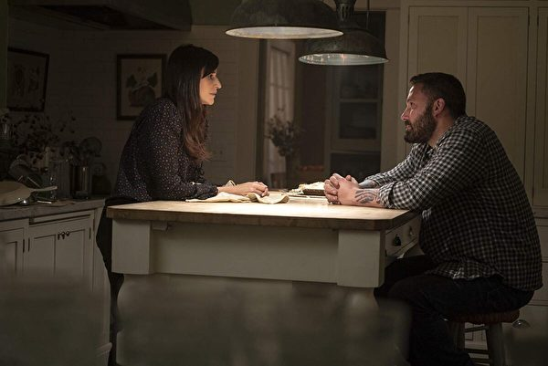 "Michaela Watkins and Ben Affleck play brother and sister in ""The Way Back."" (Warner Bros.)"