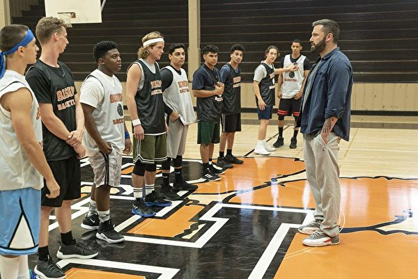 "Jack (Ben Affleck, R) meets his team for the first time in the high school basketball movie ""The Way Back."" (Warner Bros.)"