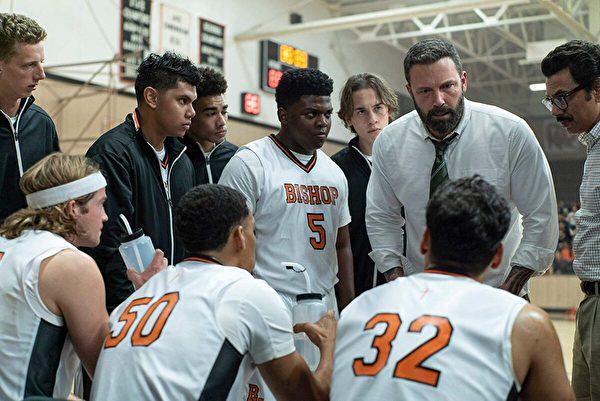 "Jack Cunningham (Ben Affleck, 2nd R) coaches his team with vehemence in the high school basketball movie ""The Way Back."" (Warner Bros.)"