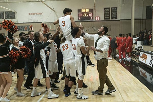 "Jack Cunningham (Ben Affleck, R) celebrating a win with his team in the high school basketball movie ""The Way Back."" (Warner Bros.)"