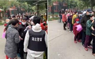 视频:武汉社区排长龙领票 网民忧交叉感染