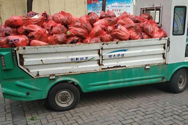 袁斌:武漢官員用垃圾車給居民運肉是工作失誤?