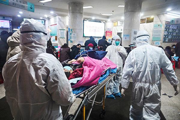 武漢肺炎疫情在去年底爆發,但中共當局從地方到中央一直隱瞞疫情,致使疫情失控,並傳到海外多個國家和地區。(HECTOR RETAMAL/AFP via Getty Images)