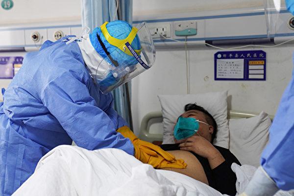 感染了中共肺炎以后,病人有三种较常见的反应。(STR/Getty Images)