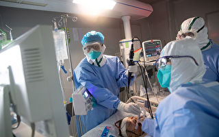 """""""中共肺炎""""(又称武汉肺炎、COVID-19)爆发后,哪些医护人员坚守第一线?(STR/Getty Images)"""