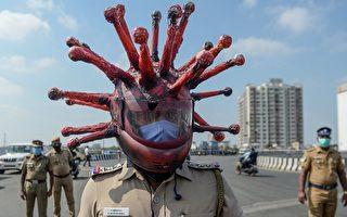 印度警察戴病毒状安全帽 警告民众待在家里