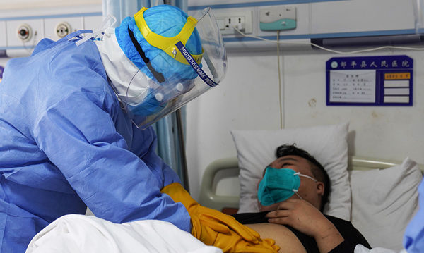 感染了武漢肺炎以後,病人有三種較常見的反應。(STR/Getty Images)