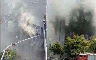 4月28日上午9时左右,合肥火车站附近的一窗帘家纺广场发生火灾。(视频截图合成)