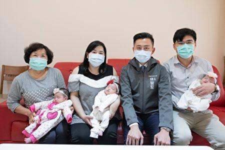 同為三寶爸的林智堅與年輕的夫婦及阿嬤分享育兒經驗,暖心祝福三胞胎「乖乖長大」。