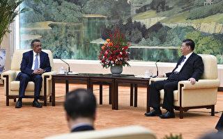 譚德塞今年1月28日會見習近平時,大力讚賞中共,對中共和謊言和掩蓋絲毫不提。 (NAOHIKO HATTA/AFP via Getty Images)