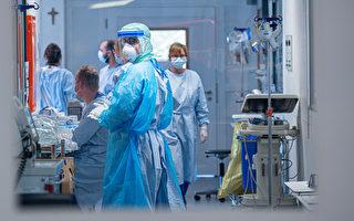 中共肺炎疫情大爆发,造成医护人力严重不足。 (Sascha Schuermann/Getty Images)