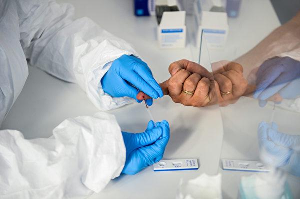 抗体检测若是伪阳性,将会让没有免疫力的人复工。(Omar Marques/Getty Images)