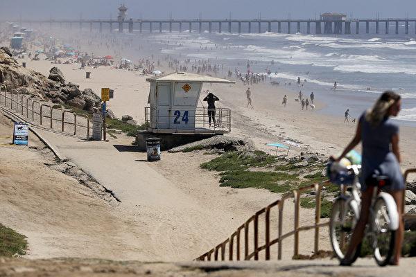 美多州重启部分经济 放松居家令开放海滩