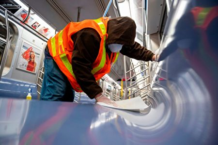 A New York City Mass Transit Authority (MTA) transit worker cleans a subway car at the Coney Island station in Brooklyn, New York on May 6, 2020. - The New York City subway system is being suspended between 1 AM and 5 AM EDT starting tonight so that trains may be cleaned to stop the spread of the coronavirus. (Photo by COREY SIPKIN / AFP) (Photo by COREY SIPKIN/AFP via Getty Images)