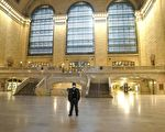 A MTA employee stands in a empty Grand Central Terminal during the morning rush hour in New York City on May 6, 2020. - Authorities say conditions in New York -- the epicenter of the pandemic, with more than 19,000 confirmed or probable deaths -- are slowly improving, but that it's too soon to relax confinement measures. (Photo by TIMOTHY A. CLARY / AFP) (Photo by TIMOTHY A. CLARY/AFP via Getty Images)