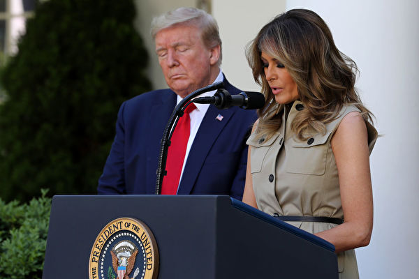 WASHINGTON, DC - MAY 07: U.S. first lady Melania Trump prays with President Donald Trump during a National Day of Prayer event in the Rose Garden at the White House May 07, 2020 in Washington, DC. The White House invited faith leaders from across the country to participate in the event which was held during the novel coronavirus pandemic. (Photo by Chip Somodevilla/Getty Images)