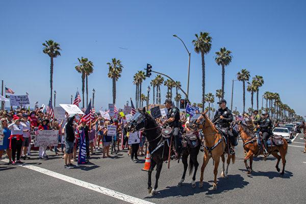 用抗议推动重新开放 考验加州州长纽森的决心