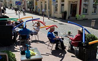 社交距離妙主意!德國喝咖啡戴「竹蜻蜓帽」