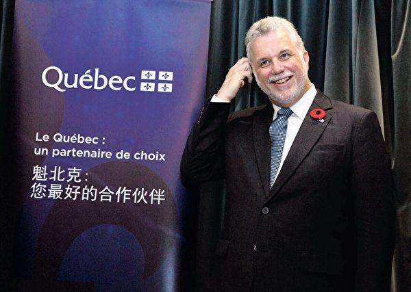 2014年10月29日,魁北克省前省長菲利普・庫亞爾(Philippe Couillard)在北京出席加拿大公司與中國同行之間的簽署儀式。(美聯社/Ng Han Guan)