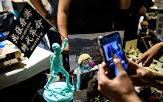 拒移抗议者塑像 港童装店老板:教孩子们民主