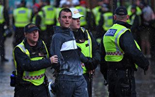 英首相:种族暴力没有市场 袭警将受法律制裁