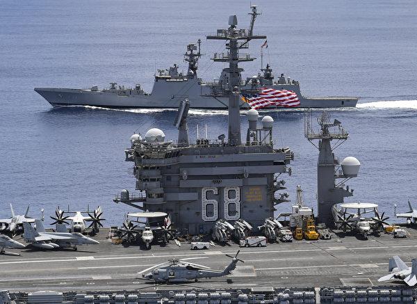 7月20日,美國海軍尼米茲號航母(USS Nimitz)戰鬥群和印度海軍軍艦在安達曼-尼科巴群島(Andaman and Nicobar islands)附近舉行聯合軍演。(U.S. Navy photo by Mass Communication Specialist 3rd Class Jose Madrigal)