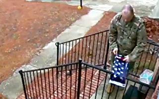什么叫真爱国:陌生军人叠好受损国旗