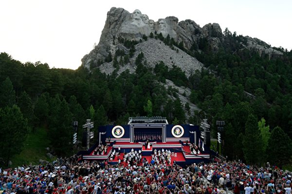 US President Donald Trump and First Lady Melania Trump arrive onstage during an Independence Day event at Mount Rushmore in Keystone, South Dakota, July 3, 2020. (Photo by