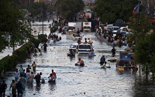 组图:巴基斯坦卡拉奇洪灾 至少36人罹难