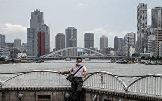 组图:日本疫情持续升温 单日确诊首度破千
