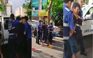 视频显示,在大街上小摊贩被城管扭送带走。(视频截图合成)