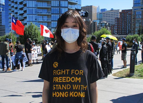 活動組織者凱瑟琳·梁表示,中共不是香港的問題,而是全世界的問題。(林采楓/大紀元)