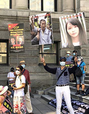 图:温支联等组织举办大型游行与集会,逾500人参加,联手加国其他9个城市,共同呼吁制裁中共营救手足。(邱晨/大纪元)