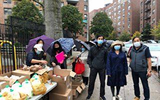 亚裔社区组织在森林小丘免费派发食品