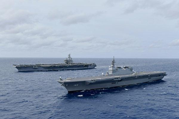 2019年6月11日,在南中國海,美軍的列根號航空母艦(CVN 76,上),與日本海上自衛隊(JMSDF)的直升機航母出雲號(DDH 183,下)一起演練。(美國海軍)