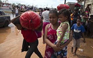 组图:飓风艾奥塔来袭前 中美洲居民撤离