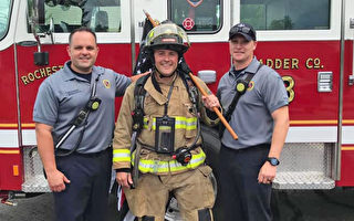 美國消防員著裝步行140英里 為癌症隊友募款