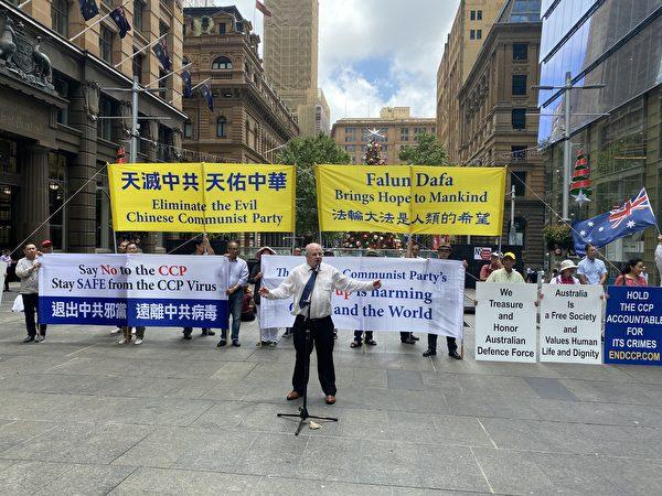 12月10日,澳洲退黨服務中心在悉尼市中心馬丁廣場舉辦集會,紀念國際人權日,抗議中共霸凌澳洲,拒絕中共滲透,呼籲終結中共。澳洲悉尼Parramatta市議員威爾森( Andrew Wilson)在集會上發言。(李睿/大紀元)
