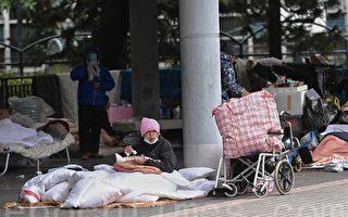 组图:港府扶贫不力 无家可归者增多