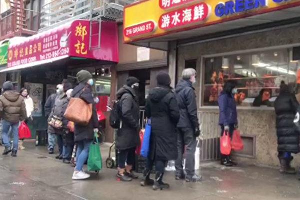 纽约华人忙办年夜饭 烧腊店前大排长龙
