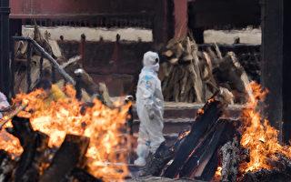 印度疫情失控,何時才能停止?圖為印度一處火葬場景象。 (Anindito Mukherjee/Getty Images)