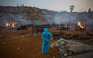 杨景段指出,印度病毒量高,感染风险更大。(Abhishek Chinnappa/Getty Images)
