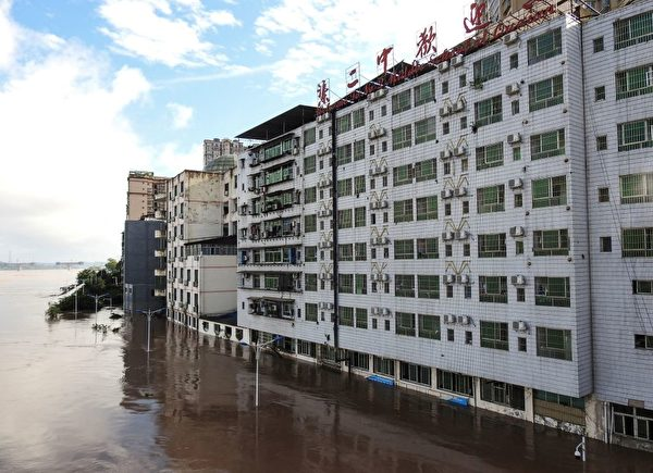 On July 11, the building was flooded after heavy rains in Dazhou City, Sichuan Province.  (STR/AFP via Getty Images)