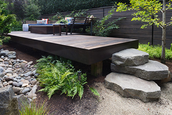 Three,Massive,Rocks,Form,Steps,To,A,Contemporary,Deck,With