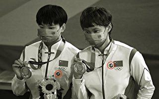 国际奥委会了结戴毛像章案:已警告中国选手