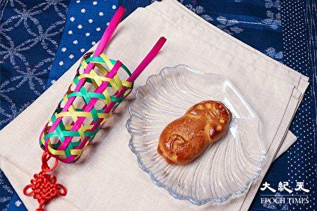 沒有餡料的「豬仔餅」,是餅家設計的趣味造型,作為贈品送給客人。因用竹籠盛裝,因而又名「豬籠餅」。(陳仲明/大紀元)