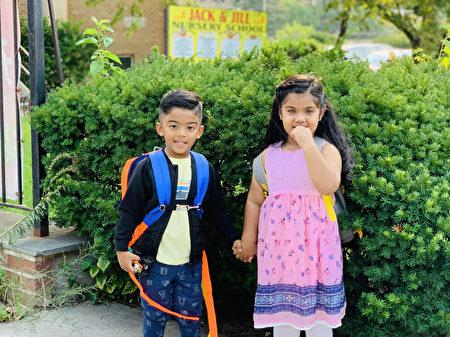 9月13日,纽约公校开学,朱蒂.苏丹娜(Juthi Sultana)带着2岁半的侄子和3岁的女儿回托儿所。