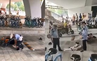 广州警察用膝盖压司机致瘫软 视频热传