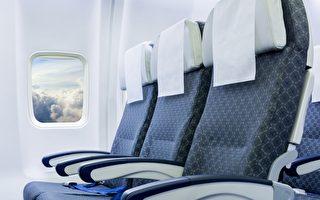 飞机上一排三个座位 谁能使用中间的扶手?
