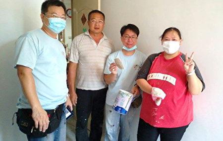左一江宏祥參加愛家服務行動。